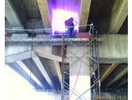 Metalizing underneath a bridge
